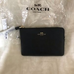 Coach black leather wristlet. Brand new with tags.